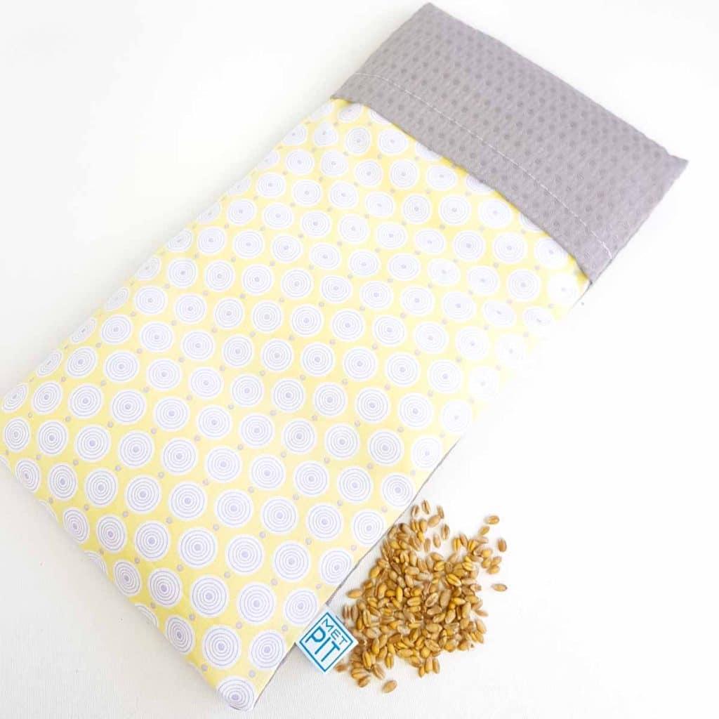 Pittenzak warmtekussen en coldpack grijs met gele print